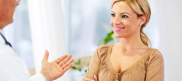 Doctor talking to a female patient.   [url=http://www.istockphoto.com/search/lightbox/9786662][img]http://dl.dropbox.com/u/40117171/medicine.jpg[/img][/url]